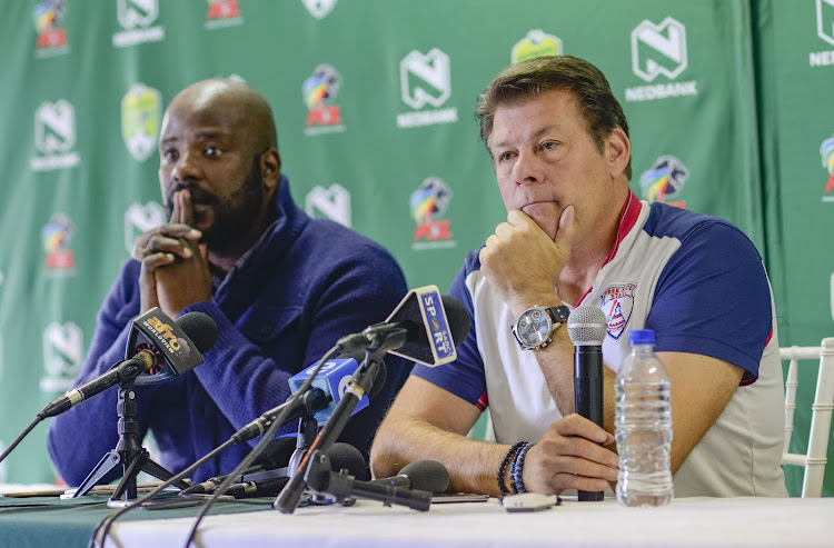 Free State Stars manager Rantsi Mokoena (L) says reports linking his head coach Luc Eymael (R) with the vacant coaching job at Kaizer Chiefs has affected his team in their last seven matches and added that it undermined his team.