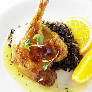 Roasted Duck Legs With Orange Sauce and Wild Rice.