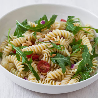 Pasta Salad with Tomatoes, Arugula, Pine Nuts and Herb Dressing.