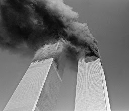 Photo: The World Trade Centre towers blaze after two airplanes crashed into them.