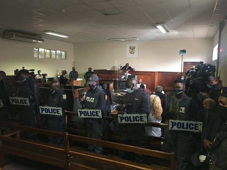 Police were lined up in court to stop potential violence from breaking out.