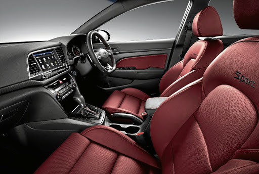 Deep red sports seats add to the sporty appeal. Picture: QUICKPIC