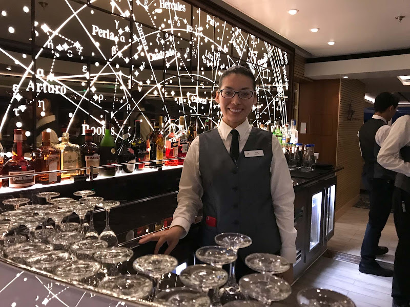 Elisa, who hails from Peru, tends bar at the Explorers Lounge on Viking Sun.