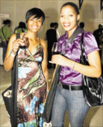 STYLISH SIPPERS: Nomaswazi Tshabalala and Phumlile Dlamini were among the thousands of people who came to appreciate more than 800 wine labels on show at the Standard Bank Soweto Wine Festival at the weekend. Pic. Robert Magwaza. © FrontPage Pix.