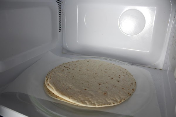 Zap the flour tortillas in the microwave for about 20 seconds to make them...