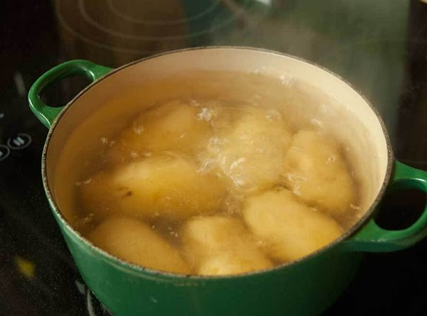 Boil the potatoes with the skins on until tender, about 30 to 40 minutes