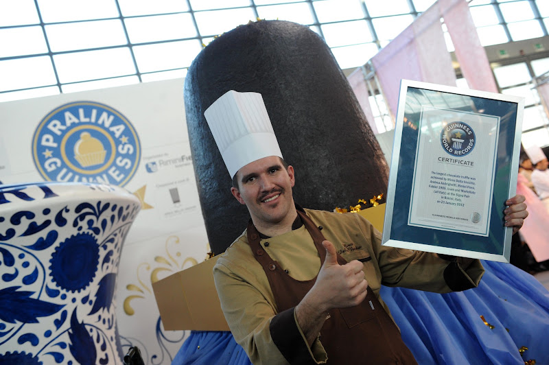Photo: The largest chocolate truffle weighted 802 Kg (1,768 lb 11 oz) and was achieved by Mirco Della Vecchia, Andrea Andrighetti, Rimini Fiera, Fabbri 1905, Icam and Martellato (all Italy) at the Sigep Fair in Rimini, Italy.   The ingredients used for the chocolate truffle were: dark chocolate 1,000 Kg (2,204 lb 62 oz); amarena cherries 200 kg (440 lb 92 oz); cream 200 kg (440 lbs 92 oz).
