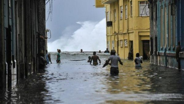 Residents wade through a flooded street in Havana, on September 10, 2017.