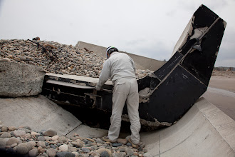 Photo: May 7th, Odaka, Fukushima, Japan. Kobayashi points out that the sections of the seawall were connected only by rubber, and were easily torn apart by the tsunami. The seawall in a neighboring town was connected by steel and survived the tsunami intact.