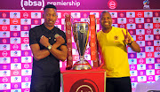 Orlando Pirates captain Happy Jele (L) pose with the Absa Premiership trophy alongside his Kaizer Chiefs counterpart Itumeleng Khune (R) on October 24, 2018 at the Premier Soccer League headquarters in Parktown, north of Johannesburg.