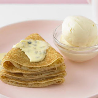 Crêpes with Ice Cream and Passionfruit Sauce.