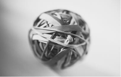 Description: RUBBER BANDS, LIKE THE ONES SHOWN HERE FORMED INTO A BALL, ARE A CLASSIC EXAMPLE OF ELASTIC DEFORMATION. (Photograph by Klein/Corbis. Reproduced by permission.)