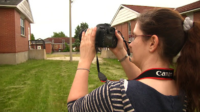 Photo: Rhonda taking a picture of one of the buildings in the compound.