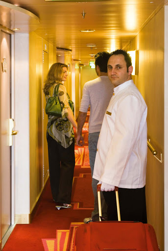 msc-cruises-butler.jpg - A butler assists a couple with their luggage during a sailing on MSC Cruises.