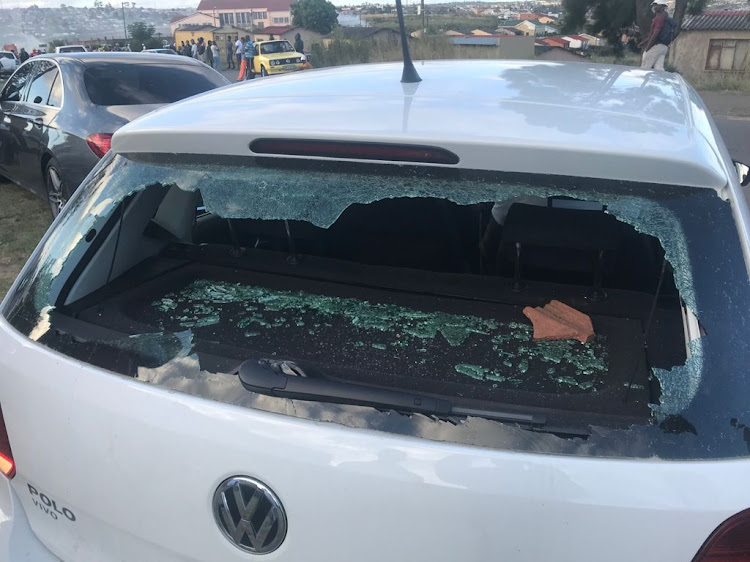One of the cars with smashed windows after ANC members fought in Mdantsane on Monday afternoon.