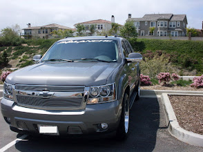 Photo: Front view. Avalanche model. Shows headlight trim, billet grill, grill surround, billet bowtie, billet tow hook grills, chrome mirror bottoms, Windshield decal. Buy at http://www.AvalancheAndAccessories.com Buy other auto and truck accessories at: http://www.AutoAccessoriesNow.com