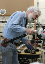 Photo: Lastly he pulled out the Ellsworth Signature gouge.  Here he is setting the nose angle for grinding using his jig.