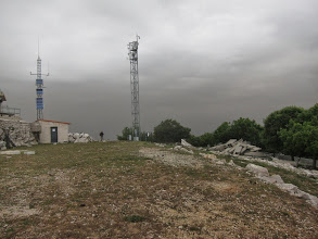 Photo: A jumble of cell phone towers and ruined fortifications, it's no place to linger, especially as we hear distant thunder.