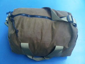 Photo: This Filson small tin cloth duffel it my overnight bag and it has even a Barbour coat, a bottle of Scotch (as gift) etc