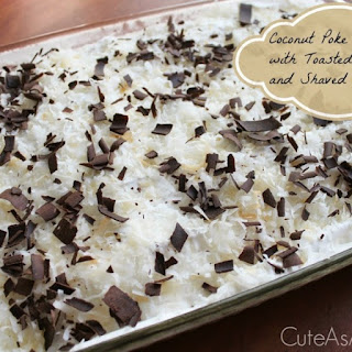 Coconut Poke Cake with Toasted Coconut and Shaved Chocolate