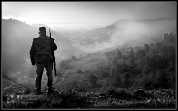 Photo: This morning, I went almost every day, walking down the mountain. Today was a foggy day, my equipment was not, and I have only a Fuji pocket camera. I was taking pictures of the fog, but needed something in the foreground. Then I saw a hunter that served this purpose...