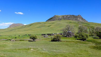 Photo: Abandoned ranchhouse with Lionhead Butte in background - taken as I was driving SW on Birdtail Road.