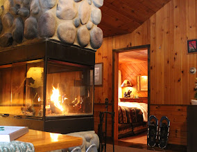 Photo: A floor to ceiling wood burning fireplace