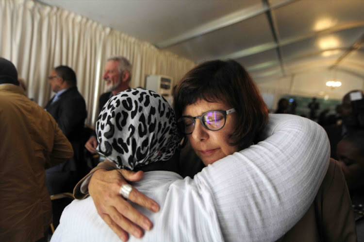 Gauteng Finance MEC Barbara Creecy hugs Bertha Molefe, mother of Sophia Molefe who was also a victim of the tragedy at the Life Esidimeni arbitration hearings on January 30, 2018 in Johannesburg.