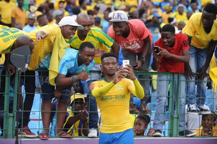Motjeka Madisha and fans take a selfie during the Absa Premiership match between Mamelodi Sundowns and Bloemfontein Celtic at Loftus Versfeld Stadium on December 16, 2017 in Pretoria, South Africa.