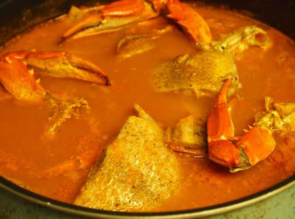 Red Snapper, Blue Crab And King Crabs In A Mild Spicey Tomato Soup