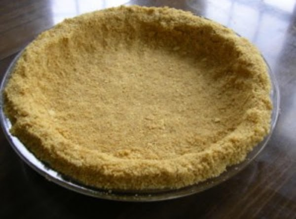 To Prepare the Crust:Add the sugar to the cracker crumbs and mix. Pour in...