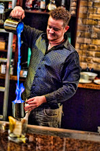 "Photo: Here is a really fun shot of Russell ""Rockstar"" Davis, from RockstarBartender.com, pouring a flaming drink called the ""Blue Blazer"". You can actually see the video of him making it and pouring at http://onemansblog.com/blazer"