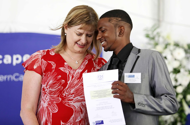 Lance Minnies of Mitchells Plain receives his award from Western Cape education MEC Debbie Schafer on January 10 2019. Minnies said that when he was depressed and wanted to give up, his teachers stood by him and pulled him through.