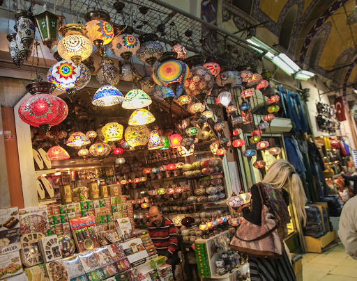 lamps-grand-bazaar.jpg - A women admires the assortment of colorful lamps at a shop in the Grand Bazaar in Istanbul.