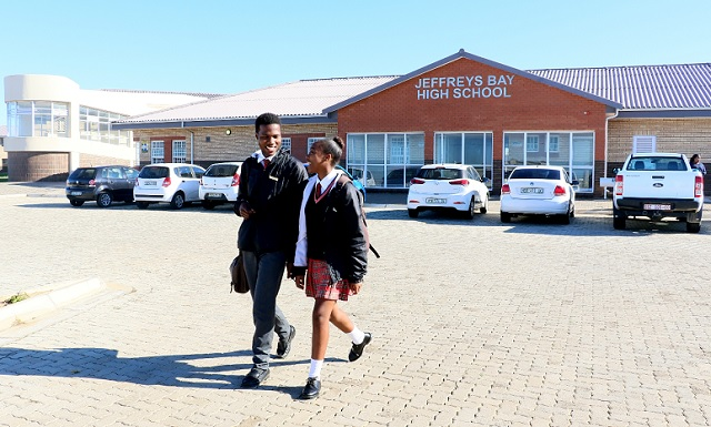 Two of Jeffreys Bay Comprehensive High School's first group of matric pupils, proudly leave school after writing exams.