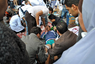 Photo: Another victim treated in the makeshift field hospital in Tahrir Square.