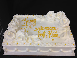 Photo: Classic Anniversary sheet cake featuring Lisa's traditional border w/White whipped cream frosting roses and gold writing.