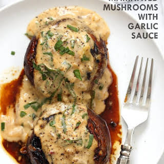 Grilled Portobello Mushrooms with Garlic Sauce.