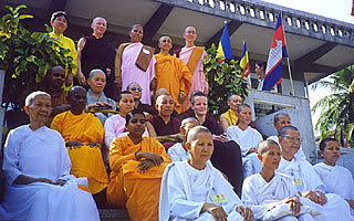 Photo: Nuns from 12 countries gather before the conference site, Wat Onnalon, temple of the King's brother used only for the bi-monthly recitation cerimony for monks.