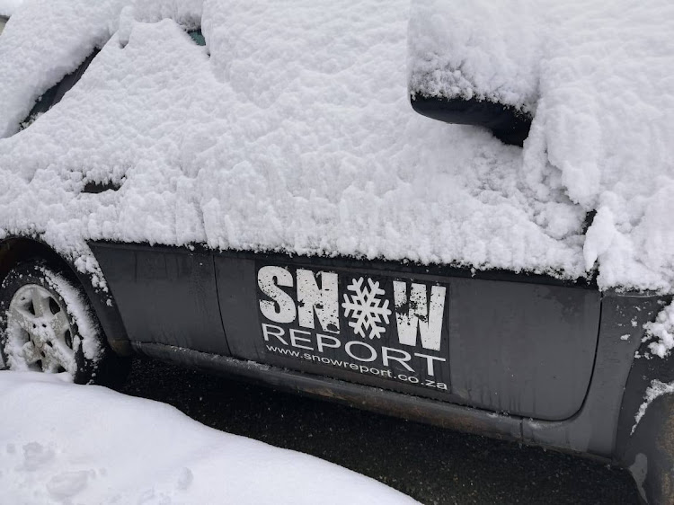 A Snow Report SA vehicle is covered in snow at the Matroosberg Reserve in Ceres' Western Cape, on July 2, 2018.