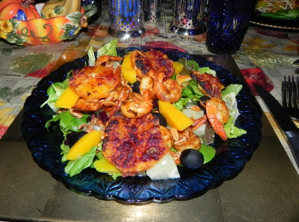 Next, lay your greens down and place your shrimp on the bed of greens....