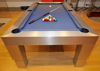 the apex pneumatic pool table with blue felt and the pool cues and balls on the table