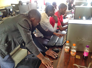Photo: Mr. Galiwango, one of the facilitators giving a helping hand to one developer