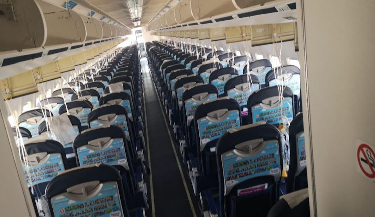 Oxygen masks dangle in the cabin of the FlySafair Boeing 737-400 after it landed safely at Cape Town International Airport in August 2019.