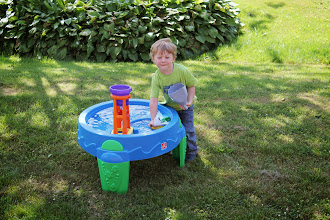 Photo: As for our boy, he got a new water table. I've been looking, and WalMart had the best price around. This will buy me a lot of time to work this summer while our Little Man splashes and plays. It's amazing how much fun water is for kids!