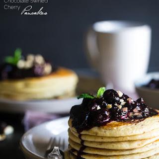 Chocolate Swirled Gluten Free Pancakes with Cherries and Hazelnuts