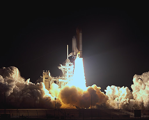 It Space Shuttle Endeavour blazes into the night sky on mission STS-113.