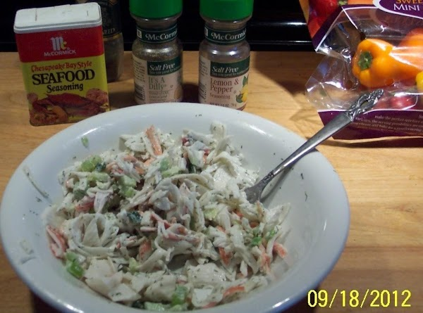 Fill the pepper cavities with the crab salad.Arrange on a serving plate, as shown....