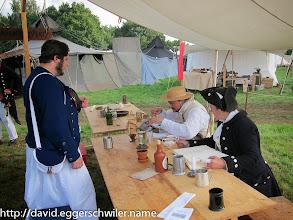Photo: Captain Michaelsen & Helmswoman Stettson handing out Pay