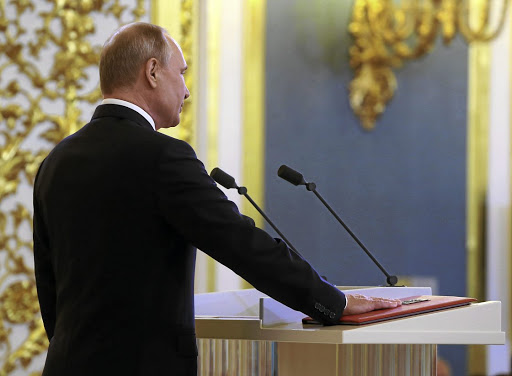 Victorious: Russian President Vladimir Putin takes the oath during his inauguration ceremony at the Kremlin in Moscow, Russia, on Monday. Picture: REUTERS